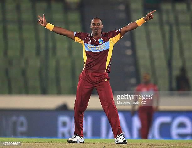 Dwayne Bravo of the West Indies celebrates bowling Sachithra Senanayake of Sri Lanka during the ICC World Twenty20 Bangladesh 2014 Warm Up match...