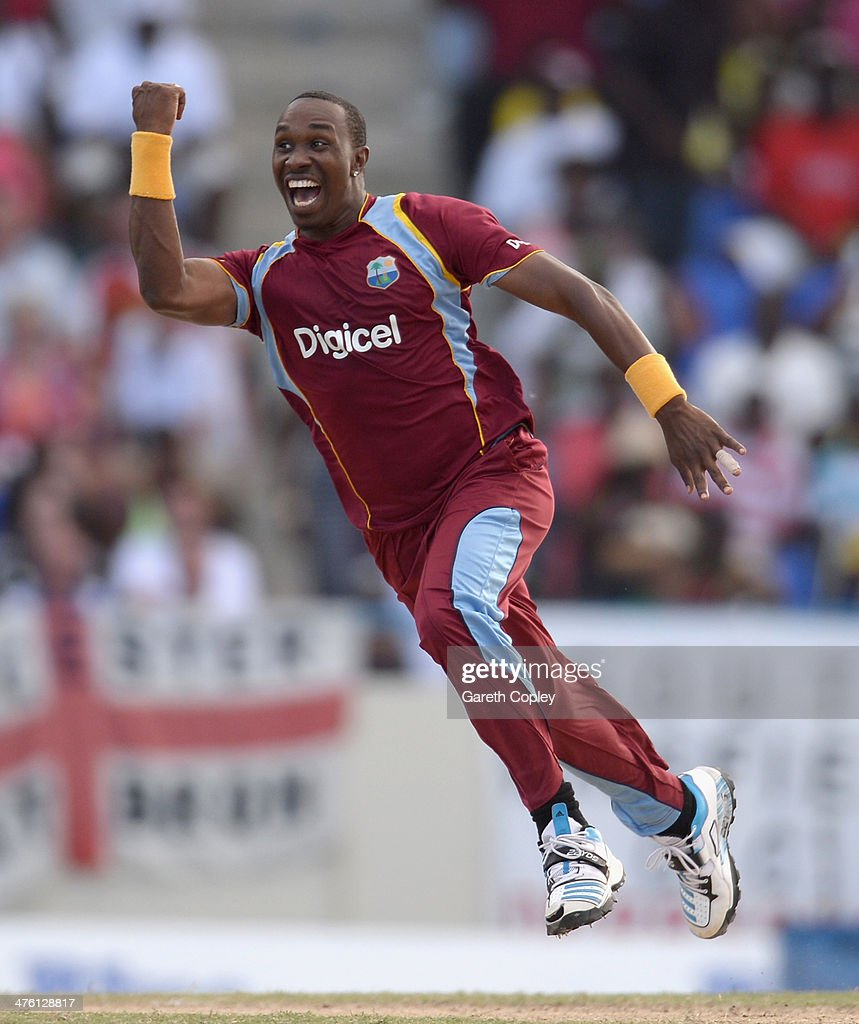 Dwayne Bravo of the West Indies celebrates catching and bowling Joe Root of England during the 2nd One Day International between the West Indies and England at Sir Viv Richards Cricket Ground on March 2, 2014 in Antigua, Antigua and Barbuda.