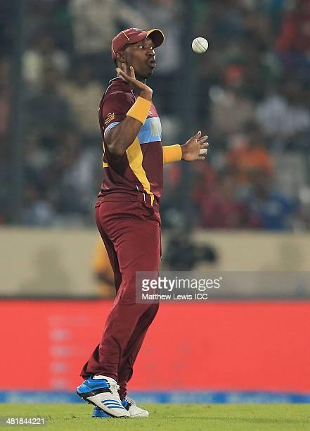 Dwayne Bravo of the West Indies celebrates catching Kamran Akmal of Pakistan off the bowling of samue Badree during the ICC World Twenty20 Bangladesh...