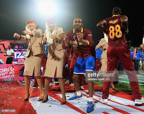 Dwayne Bravo of the West Indies celebrates his teams win after defeating England with Emirates Stewardess during the ICC World Twenty20 India 2016...