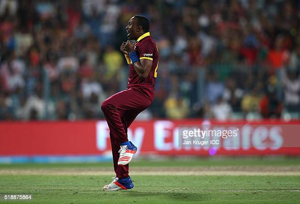 Dwayne Bravo of the West Indies celebrates the wicket of Ben Stokes of England during the ICC World Twenty20 India 2016 final match between England...