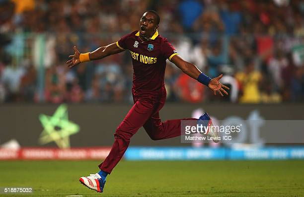 Dwayne Bravo of the West Indies celebrates the wicket of Moeen Ali of England after he was caught by Denesh Ramdin of the West Indies during the ICC...
