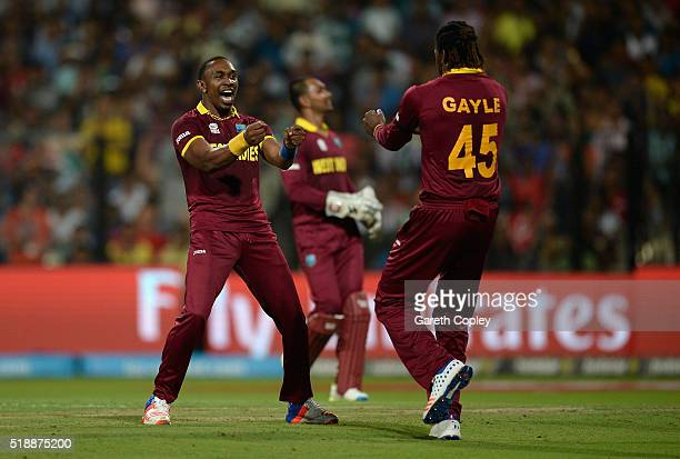 Dwayne Bravo of the West Indies celebrates with Chris Gayle after dismissing Ben Stokes of England during the ICC World Twenty20 India 2016 Final...