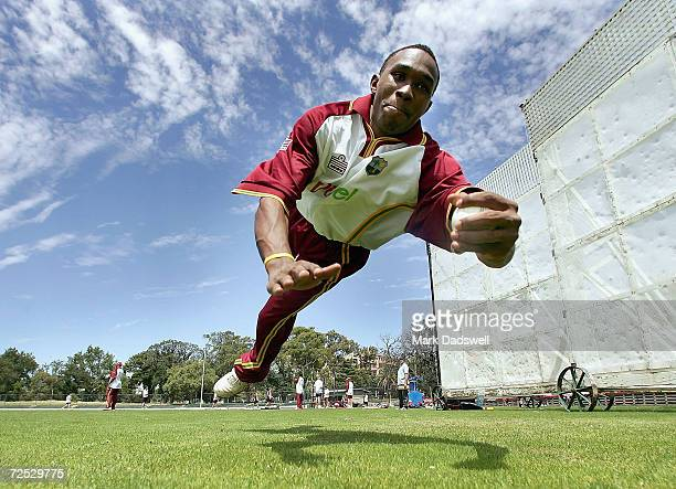 Dwayne Bravo of the West Indies dives for a catch during the West Indies Cricket teams nets session at the Junction Oval on January 3 2005 in...