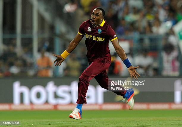 Dwayne Bravo of the West Indies runs to celebrate the wicket of Moeen Ali of England during ICC World Twenty20 India 2016 Final match between England...