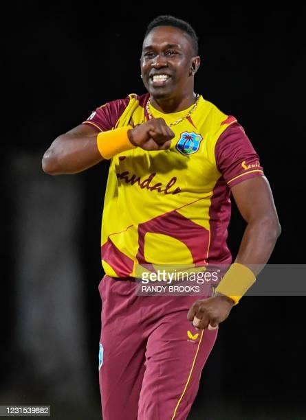 Dwayne Bravo of West Indies celebrates the dismissal of Danushka Gunathilaka of Sri Lanka during the 2nd T20i match between Sri Lanka and West Indies...