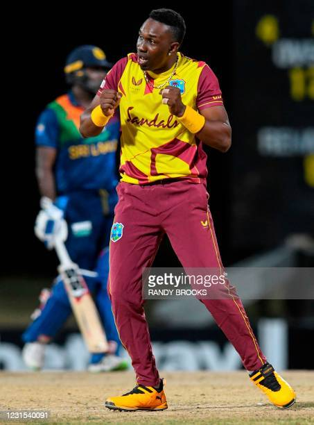 Dwayne Bravo of West Indies celebrates the dismissal of Dinesh Chandimal of Sri Lanka during the 2nd T20i match between Sri Lanka and West Indies at...