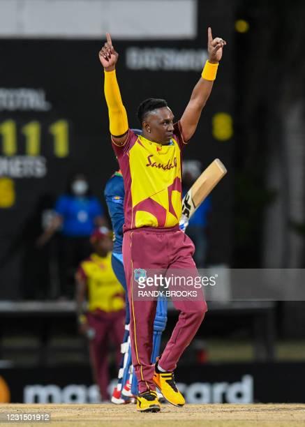 Dwayne Bravo of West Indies celebrates the dismissal of Wanindu Hasaranga of Sri Lanka during a T20i match between Sri Lanka and West Indies at...