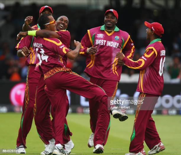 Dwayne Bravo of West Indies celebrates the wicket of Gautam Gambhir of India with Lendl Simmons during the ICC World Twenty20 Super Eights match...