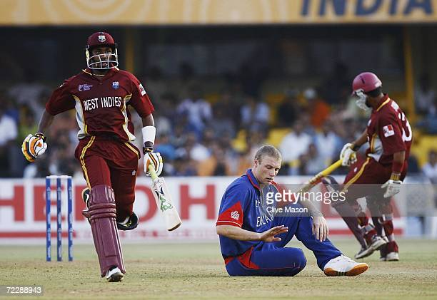 Dwayne Bravo of West Indies continues to score as Andrew Flintoff of England can only look on during the ICC Champions Trophy match between England...