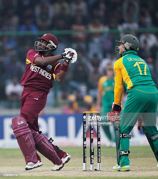 Dwayne Bravo of West Indies hits six during the 2011 ICC World Cup Group B match between West Indies and South Africa at Feroz Shah Kotla Stadium on...
