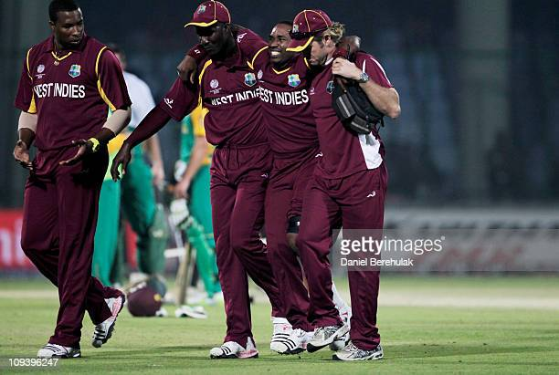Dwayne Bravo of West Indies is carried off the field after injuring himself during the 2011 ICC World Cup Group B match between West Indies and South...