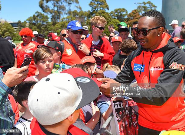 Dwayne Bravo poses with supporters and signs autographs during the Melbourne Renegades Family Day at Merv Hughes Oval on December 18 2016 in...