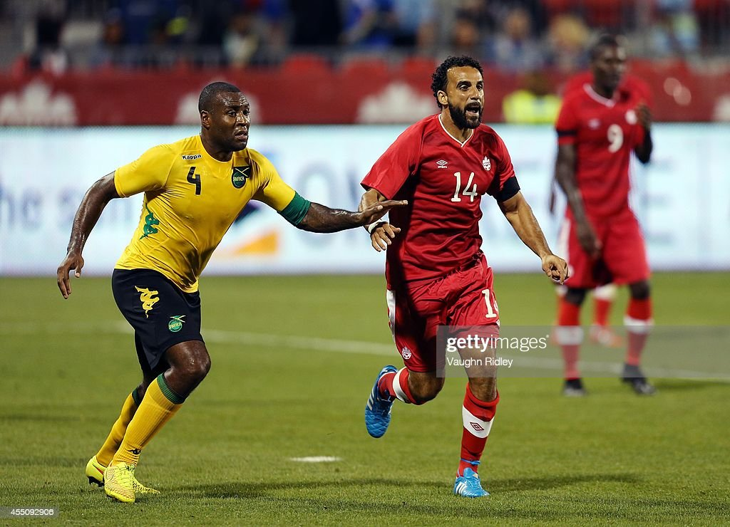 Dwayne De Rosario of Canada looks for a pass as Wes Morgan of Jamaica defends during the International Friendly match between Canada and Jamaica at BMO Field on September 09, 2014 in Toronto, Ontario, Canada.