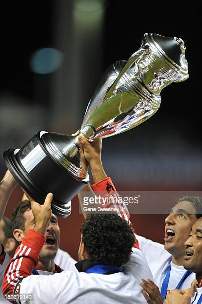 Dwayne De Rosario of D C United holds the trophy aloft after their 10 win over Real Salt Lake at Rio Tinto Stadium October 1 2013 in Sandy Utah