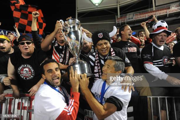 Dwayne De Rosario of DC United and Will Chang General Partner of DC United along with fans celebrate their 10 win over Real Salt Lake at Rio Tinto...