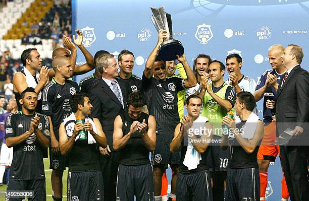 Dwayne De Rosario of MLS All-Stars holds the trophy among his teammates after defeating Chelsea in the 2012 AT&T MLS All-Star Game at PPL Park on...