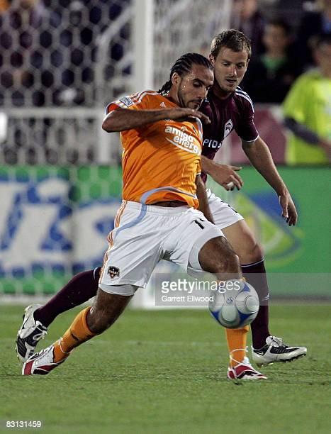 Dwayne De Rosario of the Houston Dynamo controls the ball against Jordan Harvey of the Colorado Rapids controls the ball against on October 4, 2008...
