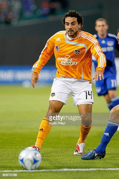 Dwayne De Rosario of the Houston Dynamo dribbles against the Kansas City Wizards during the game at Community America Ballpark on April 12 2008 in...