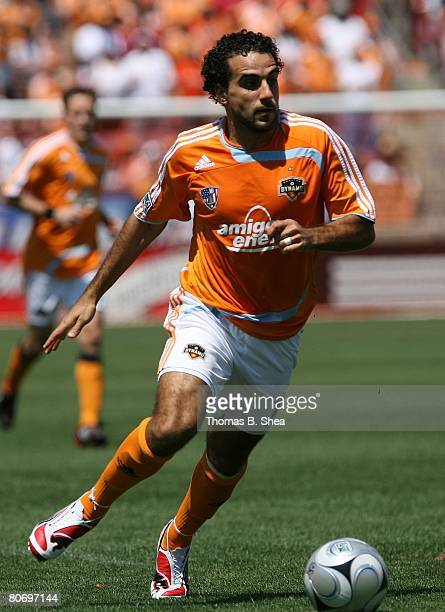 Dwayne De Rosario of the Houston Dynamo dribbles the ball against FC Dallas during an MLS game at Robertson Stadium on April 6, 2008 in Houston,...