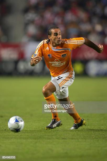 Dwayne De Rosario of the Houston Dynamo paces the ball on the attack in the first half of their MLS match against CD Chivas USA at The Home Depot...