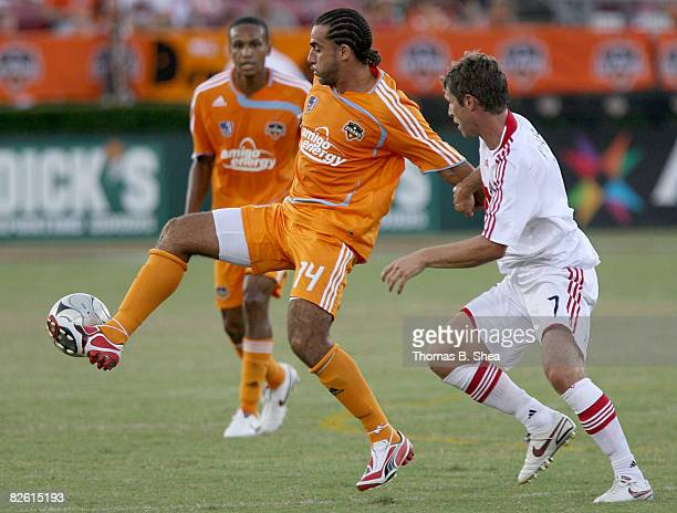Dwayne De Rosario of the Houston Dynamo traps the ball away from Logan Pause of the Chicago Fire on August 31 2008 at Robertson Stadium in Houston...