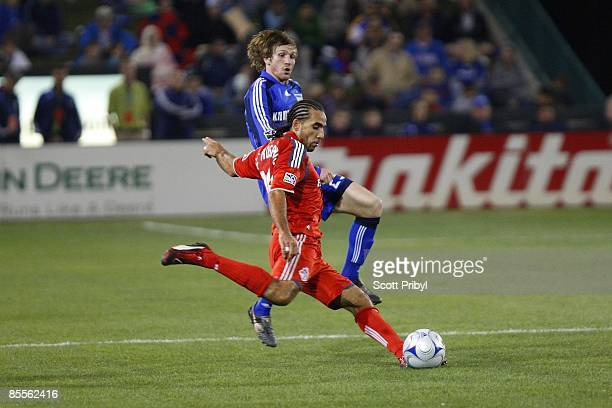 Dwayne De Rosario of Toronto FC crosses the ball against the Kansas City Wizards during the game at Community America Ballpark on March 21 2009 in...