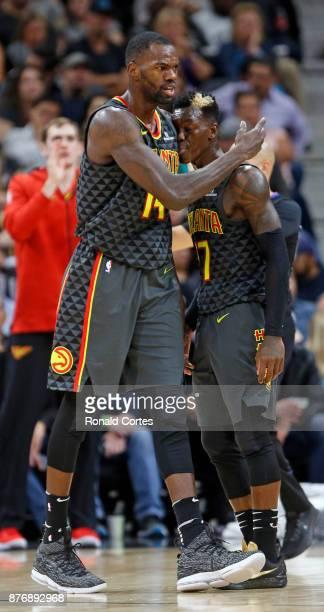 Dwayne Dedmon of the Atlanta Hawks hugs teammate Dennis Schroder of the Atlanta Hawks during a timeout in game against the San Antonio Spurs at ATT...