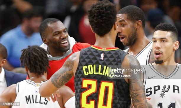 Dwayne Dedmon of the Atlanta Hawks jokes with LaMarcus Aldridge of the San Antonio Spurs at the end of the gameat ATT Center on November 20 2017 in...