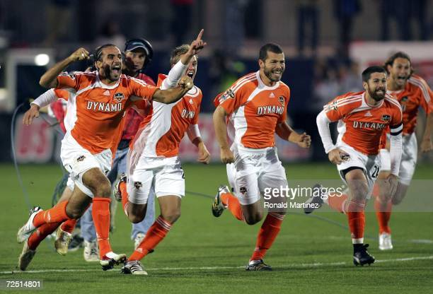 Dwayne DeRosario, Stuart Holden, Alejandro Moreno, Wade Barrett and Kelly Gray of the Houston Dynamo run to celebrate with teammate goaltender Pat...