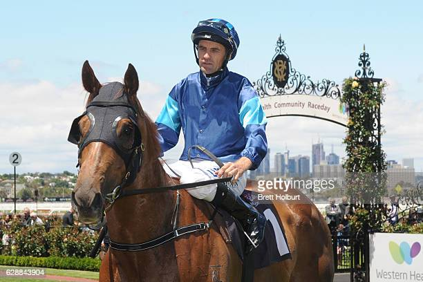 Dwayne Dunn returns to the mounting yard on Electric Tribute after winning Café Adamo Handicap at Flemington Racecourse on December 10 2016 in...