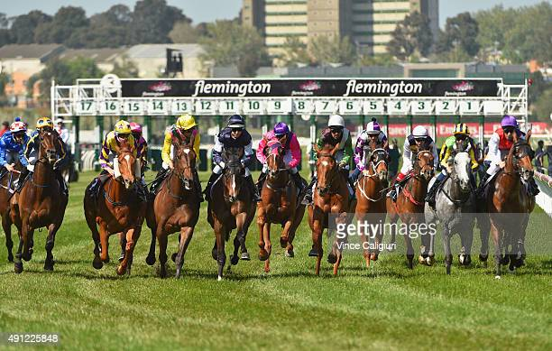 Dwayne Dunn riding Let's Make Adeal races into the first turn with the rest of field before winning Race 6 the Bart Cummings during Turnbull Stakes...