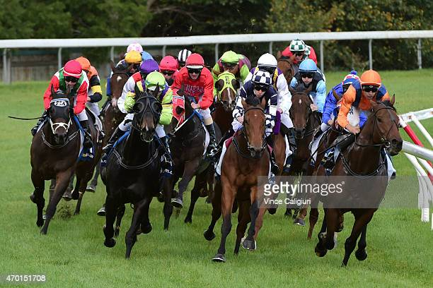 Dwayne Dunn riding Sunday Escape races into the home straight before winning Race 4 during Melbourne Racing at Caulfield Racecourse on April 18 2015...