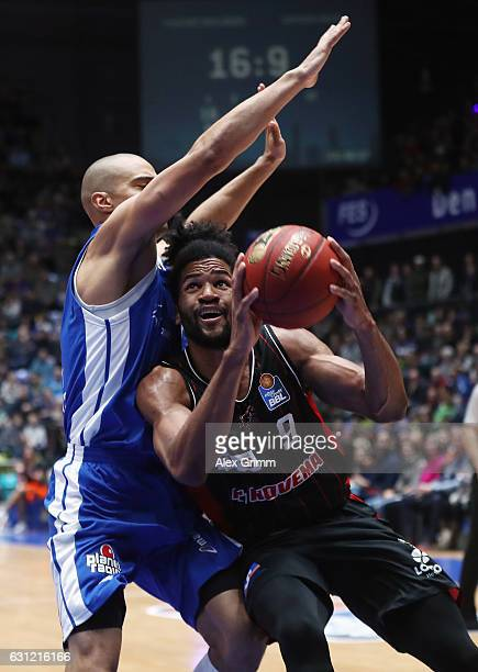 Dwayne Earl Evans of Giessen is challenged by Shawn Huff of Frankfurt during the easyCredit BBL match between Fraport Skyliners and Giessen 46ers at...