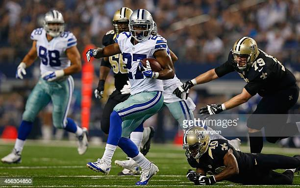Dwayne Harris of the Dallas Cowboys returns a fumble recovery as Brandin Cooks of the New Orleans Saints tries to make the tackle in the second half...