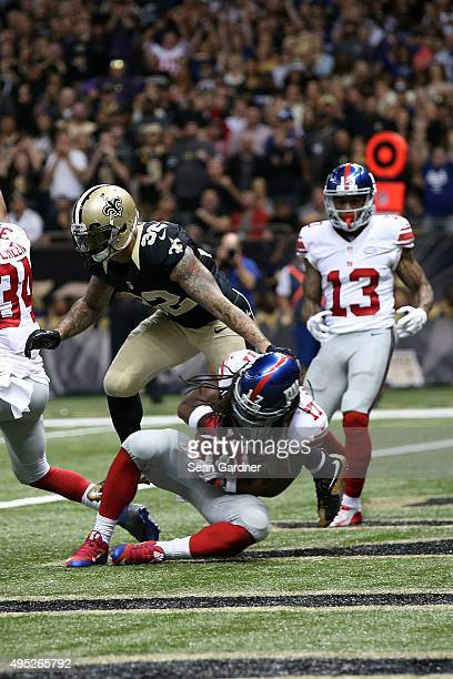Dwayne Harris of the New York Giants catches a touchdown pass during the fourth quarter of a game against the New Orleans Saints at the MercedesBenz...