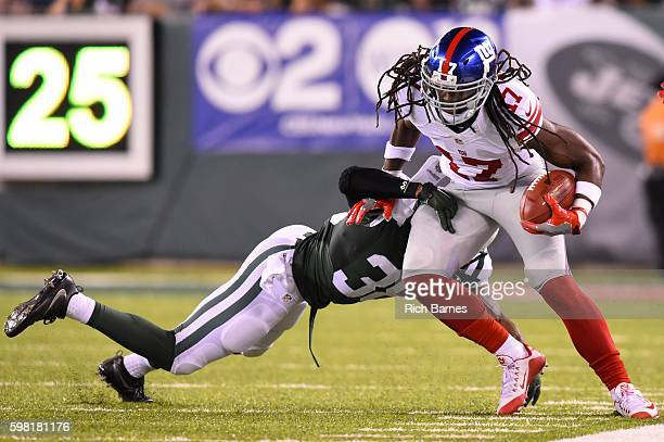 Dwayne Harris of the New York Giants returns a punt as Juston Burris of the New York Jets defends during the second quarter at MetLife Stadium on...