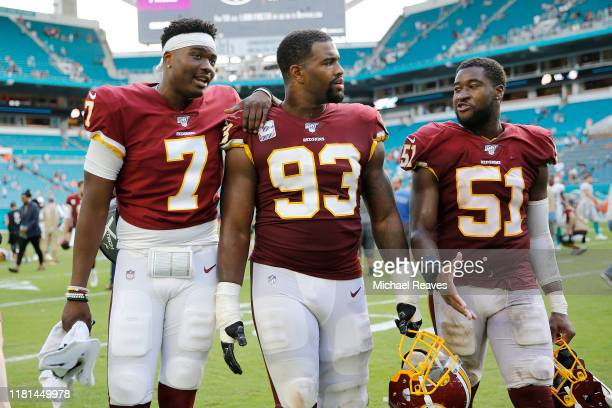 Dwayne Haskins, Jonathan Allen and Shaun Dion Hamilton of the Washington Redskins walk off the field after defeating the Miami Dolphins 17-16 at Hard...