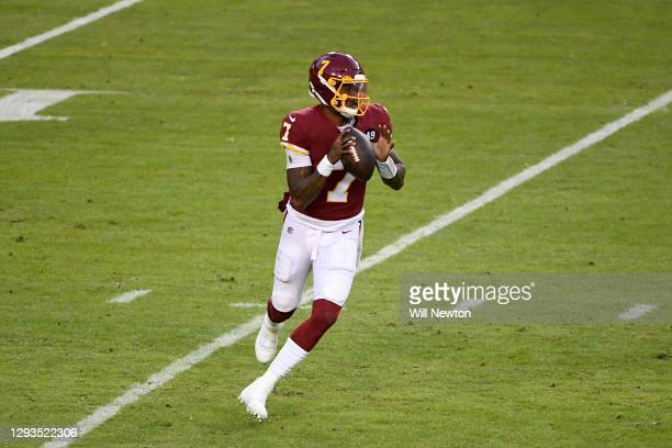 Dwayne Haskins Jr. #7 of the Washington Football Team looks to pass against the Carolina Panthers during the game at FedExField on December 27, 2020...