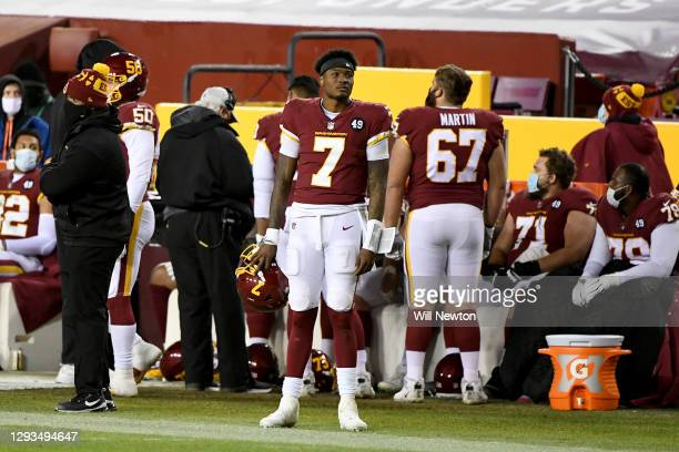 Dwayne Haskins Jr. #7 of the Washington Football Team reacts on the sideline during the game against the Carolina Panthers at FedExField on December...