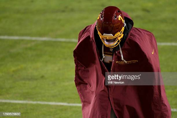 Dwayne Haskins Jr. #7 of the Washington Football Team runs off the field after the game against the Carolina Panthers at FedExField on December 27,...