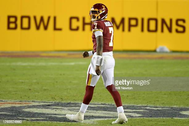 Dwayne Haskins Jr. #7 of the Washington Football Team walks off the field during the game against the Carolina Panthers at FedExField on December 27,...