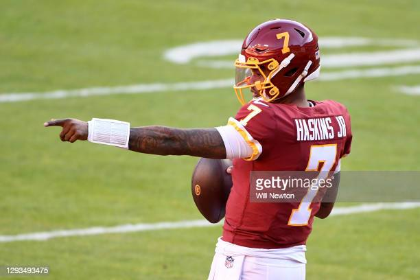 Dwayne Haskins Jr. #7 of the Washington Football Team warms up prior to the game against the Carolina Panthers at FedExField on December 27, 2020 in...