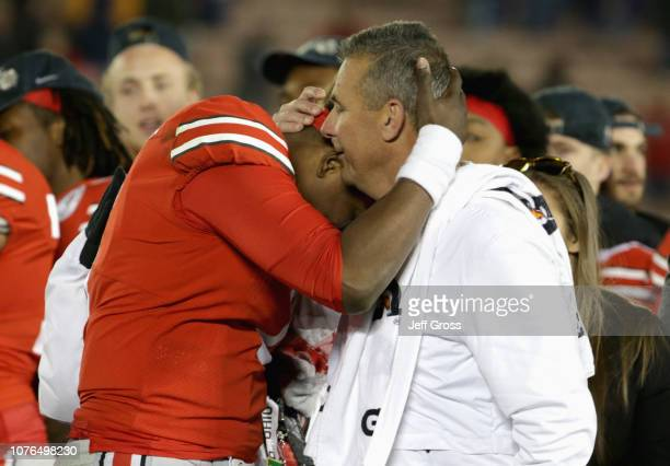 Dwayne Haskins of the Ohio State Buckeyes and Ohio State Buckeyes head coach Urban Meyer embrace after winning the Rose Bowl Game presented by...