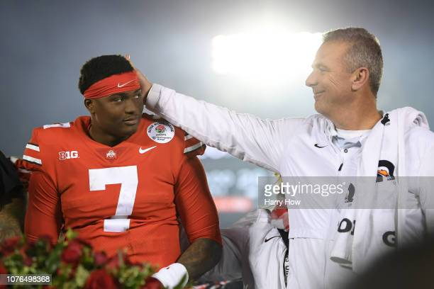 Dwayne Haskins of the Ohio State Buckeyes and Ohio State Buckeyes head coach Urban Meyer celebrate after winning the Rose Bowl Game presented by...