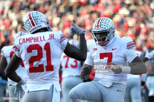 Dwayne Haskins of the Ohio State Buckeyes celebrates with Parris Campbell of the Ohio State Buckeyes after scoring against the Maryland Terrapins...