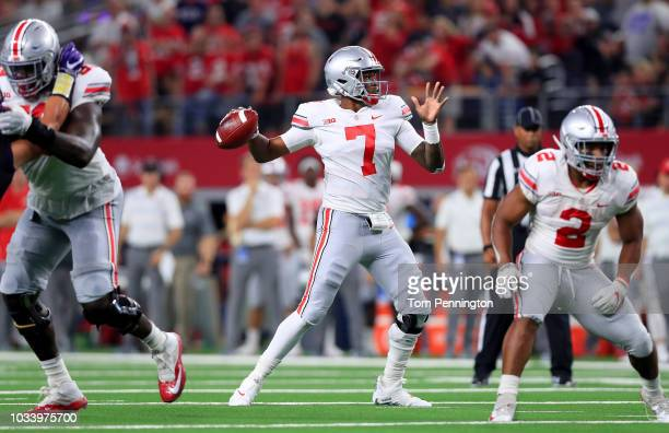 Dwayne Haskins of the Ohio State Buckeyes looks for an open receiver against the TCU Horned Frogs in the second quarter during The AdvoCare Showdown...