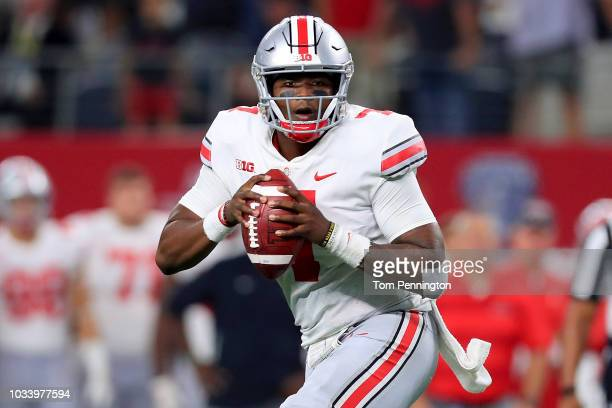 Dwayne Haskins of the Ohio State Buckeyes looks for an open receiver against the TCU Horned Frogs in the third quarter during The AdvoCare Showdown...