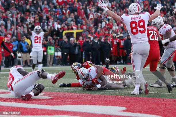 Dwayne Haskins of the Ohio State Buckeyes scores a touchdown against the Maryland Terrapins during overtime to win at Capital One Field on November...