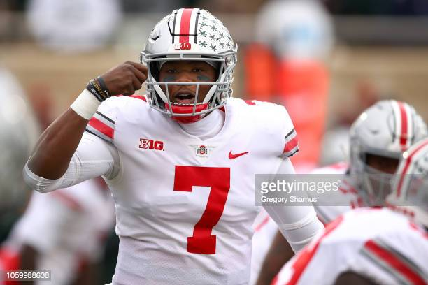 Dwayne Haskins of the Ohio State Buckeyes signals teammates while playing the Michigan State Spartans in the first half at Spartan Stadium on...